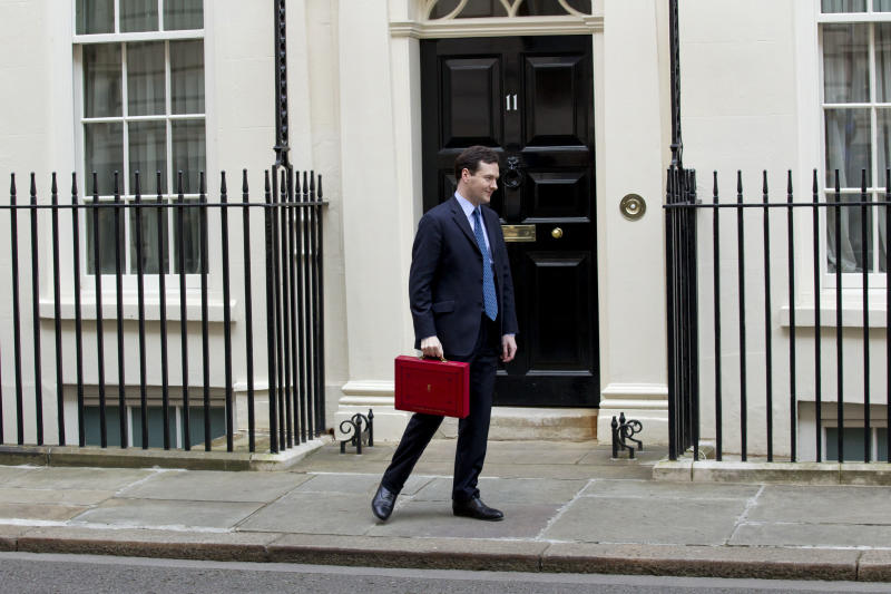 Britain's Chancellor of the Exchequer George Osborne turns to walk away after posing for the media with his traditional red dispatch box outside his official residence at No 11 Downing Street in London, as he departs to deliver his annual budget speech to the House of Commons, Wednesday, March 21, 2012. Britain's finance minister was expected to announce tax breaks for both the top and the bottom of the nation's income scale Wednesday in his annual budget, but his room for maneuver was limited by the government's drive to slash borrowing and protect its AAA credit rating. (AP Photo/Matt Dunham)