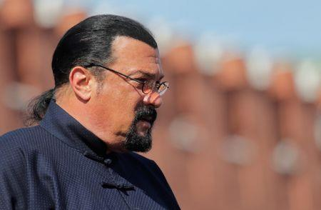 FILE PHOTO: U.S. actor Steven Seagal watches the Victory Day parade, marking the 73rd anniversary of the victory over Nazi Germany in World War Two, at Red Square in Moscow, Russia May 9, 2018. REUTERS/Maxim Shemetov/File Photo