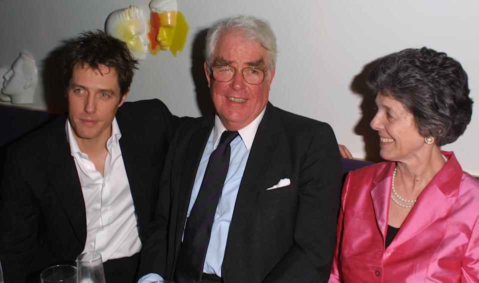 Hugh Grant (L) and parents attend the after-show party for the London premiere of 'Bridget Jones's Diary' at Mezzo, London, April 4, 2001. Grant stars in the film as Bridget Jones's boss and lover Daniel Cleaver. (Photo by Gareth Davies/Getty Images)