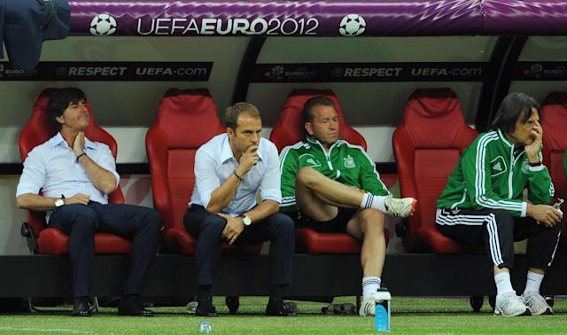 WARSAW, POLAND - JUNE 28: Head coach Joachim Loew (L) of Germany and his assistant coach Hansi Flick (2nd L) show their dejection after the UEFA EURO 2012 semi final match between Germany and Italy at the National Stadium on June 28, 2012 in Warsaw, Poland. (Photo by Christopher Lee/Getty Images)
