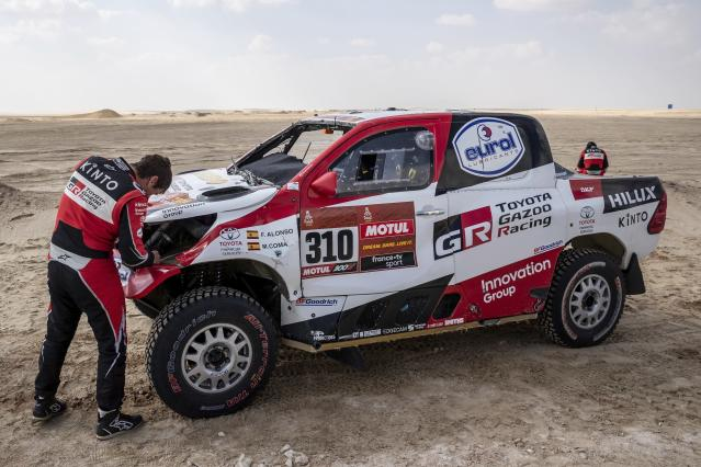Co-driver Marc Coma, of Spain, repairs his Toyota at the end of stage ten of the Dakar Rally between Haradth and Shubaytah, Saudi Arabia, Wednesday, Jan. 15, 2020. (AP Photo/Bernat Armangue)