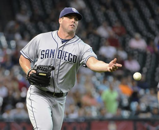 San Diego Padres pitcher Clayton Richard tosses the ball to first base for the out on Houston Astros' Jordan Schafer in the third inning of a baseball game Wednesday, June 27, 2012, in Houston. (AP Photo/Pat Sullivan)