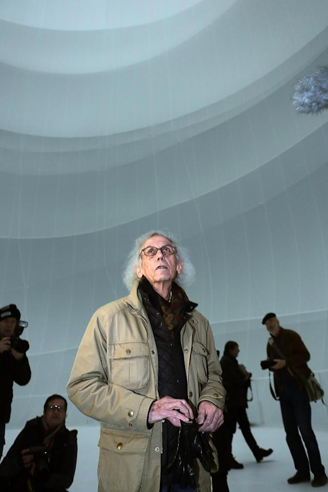 OBERHAUSEN, GERMANY - MARCH 15:  Christo, the Bulgarian-born artist know for his large-scale environmental art, leads journalists through the Big Air Package, his latest work in a former gas storage facility called the Gasometer on March 15, 2013 in Oberhausen, Germany. The piece is made from 5.3 tons of translucent material covering 20,350 square meters and shaped with 4.500 meters of cable, and fills the interior of the facility. The installation will be open to the public from March 16 through December 30. (Photo by Hannelore Foerster/Getty Images)