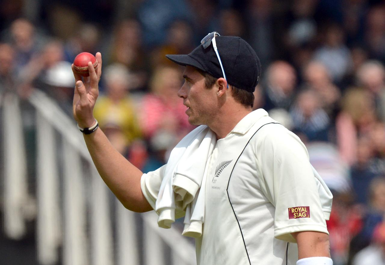 New Zealand's Tim Southee holds the ball after taking five wickets during the first test at Lord's Cricket Ground, London.