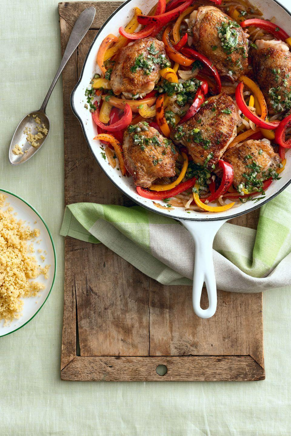 """<p>Spice up your weeknight dinner with this quick and easy chicken recipe.</p><p><strong><a href=""""https://www.countryliving.com/food-drinks/recipes/a5501/crispy-chicken-thighs-with-peppers-and-salsa-verde-recipe-clx0914/"""" rel=""""nofollow noopener"""" target=""""_blank"""" data-ylk=""""slk:Get the recipe"""" class=""""link rapid-noclick-resp"""">Get the recipe</a>.</strong></p>"""