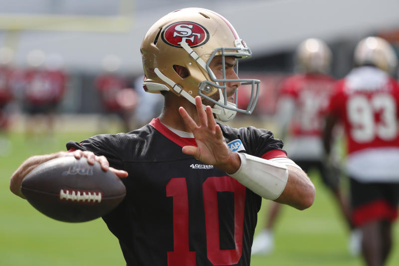 San Francisco 49ers quarterback Jimmy Garoppolo throws during practice for the NFL Super Bowl 54 football game, Friday, Jan. 31, 2020, in Coral Gables, Fla. (AP Photo/Wilfredo Lee)