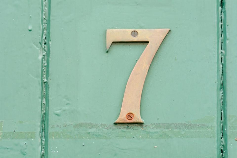 brass number seven on green door, interior design mistakes