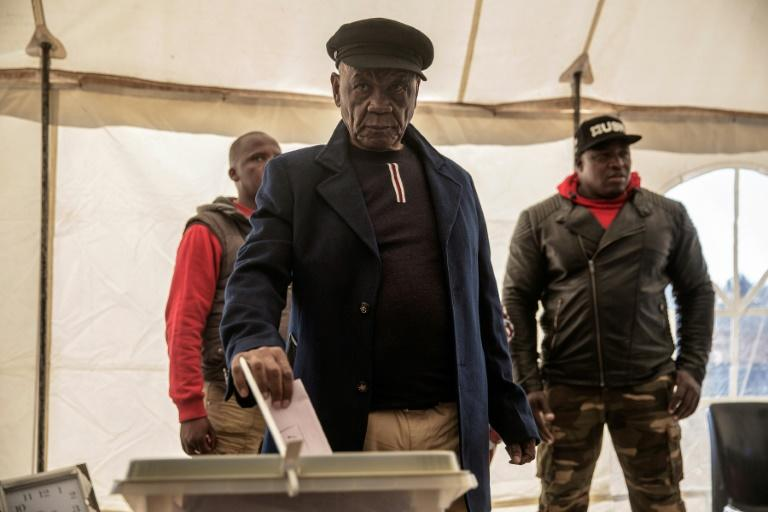 Lesotho Prime Minister Thomas Thabane (C) was summoned by police for questioning over alleged links to the 2017 murder of his estranged wife