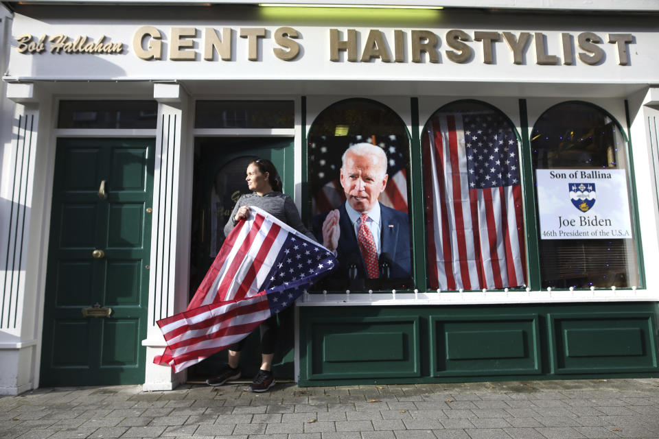 Catherine Hallahan waits for the celebrations to start in Ballina, North West of Ireland Saturday, Nov. 7, 2020. Ballina is the ancestral home of US Presidential candidate Joe Biden. (AP Photo/Peter Morrison)