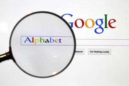 File photo of a Google search page is seen through a magnifying glass in this photo illustration taken in Berlin