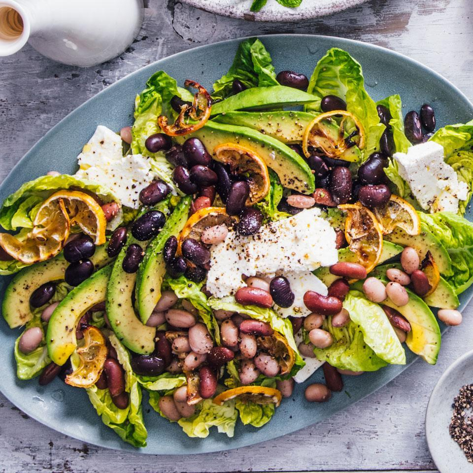 <p>Creamy avocado, salty feta cheese and sweet-bitter caramelized lemon slices make this vegetarian bean salad recipe a standout. Using different colors, sizes and shapes of beans makes this salad extra special. But any bean that interests you, even canned, will work.</p>