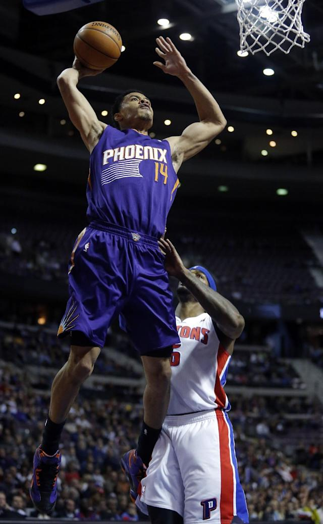 Phoenix Suns guard Gerald Green (14) goes up to dunk in front of Detroit Pistons forward Josh Smith, right, during the first half of an NBA basketball game, Saturday, Jan. 11, 2014, in Auburn Hills, Mich. (AP Photo/Duane Burleson)
