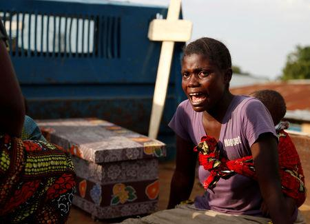 FILE PHOTO: A woman cries during the funeral of a child, suspected of dying from Ebola, next to the coffin in Beni, North Kivu Province of Democratic Republic of Congo, Dec. 17, 2018.   REUTERS/Goran Tomasevic/File Photo
