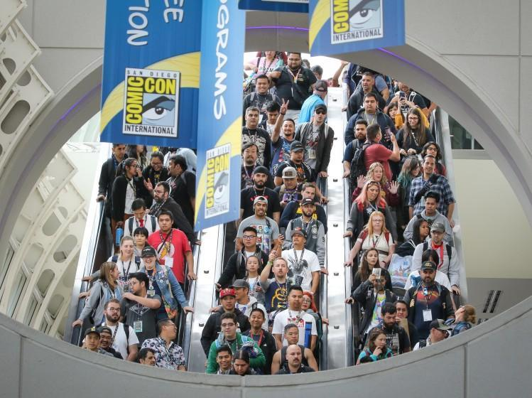 Comic-Con International Convention fans ride the escalator on the second day of the convention, July 19, 2019, at the San Diego Convention Center, in San Diego, California.