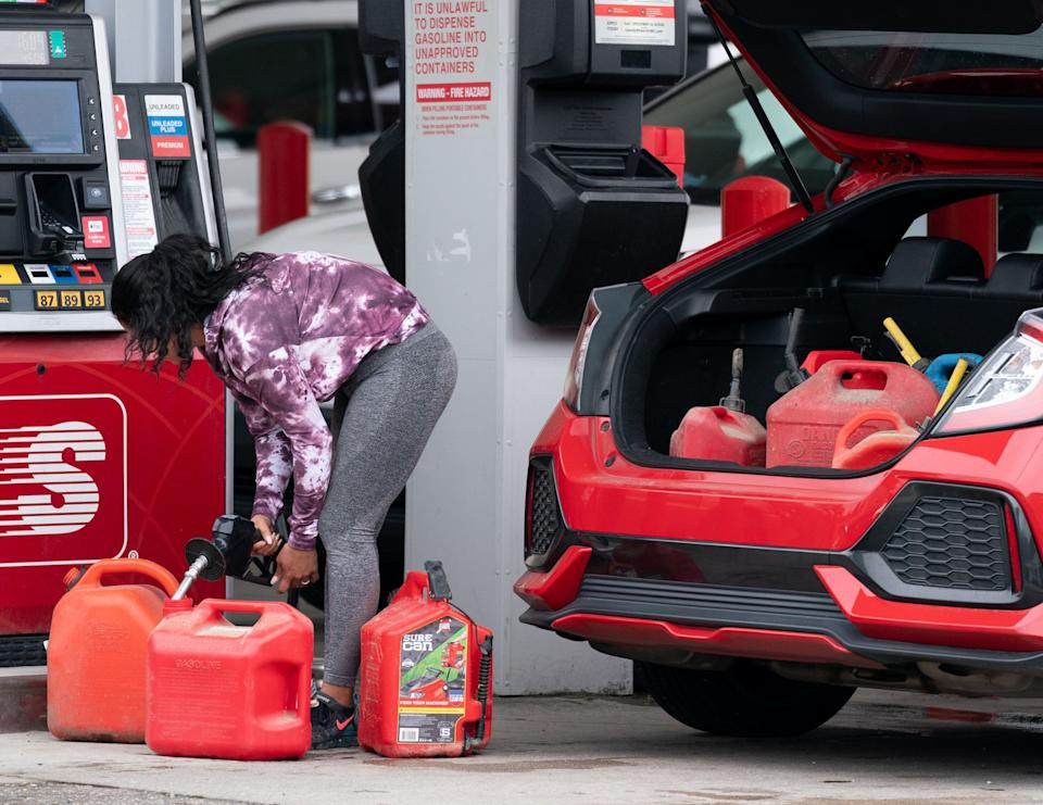 A woman fills up several gasoline cans Wednesday at a Speedway gas station in Benson, North Carolina. Most stations in the area along Interstate 95 were without fuel following the Colonial Pipeline hack. (Photo: Sean Rayford/Getty Images)
