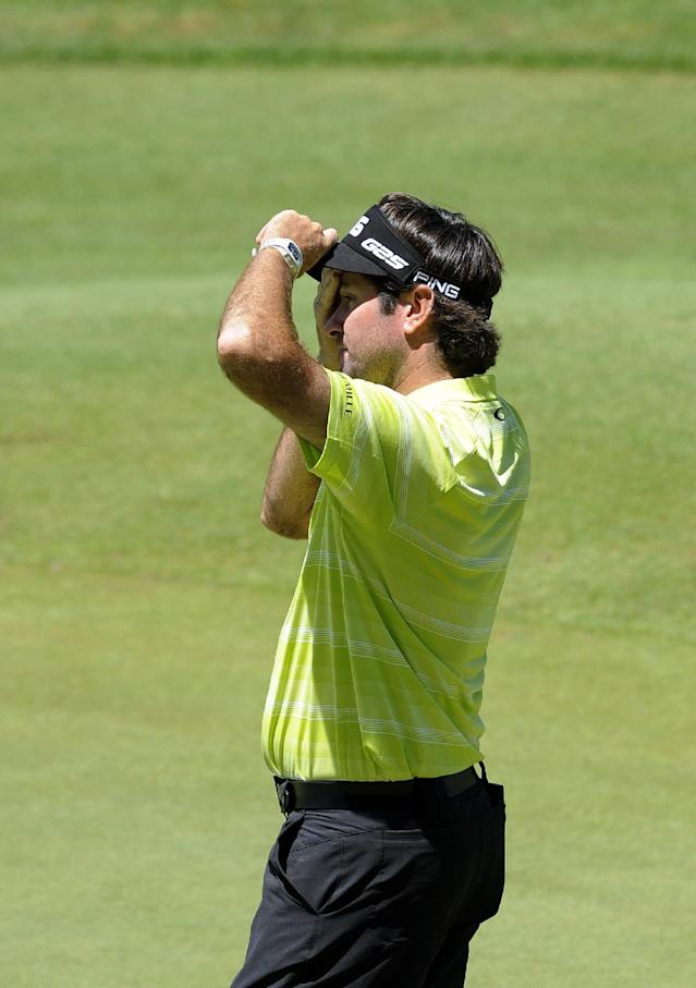 Bubba Watson reacts after finishing the third round of the Travelers Championship golf tournament in Cromwell, Conn., Saturday, June 21, 2014. (AP Photo/Fred Beckham)