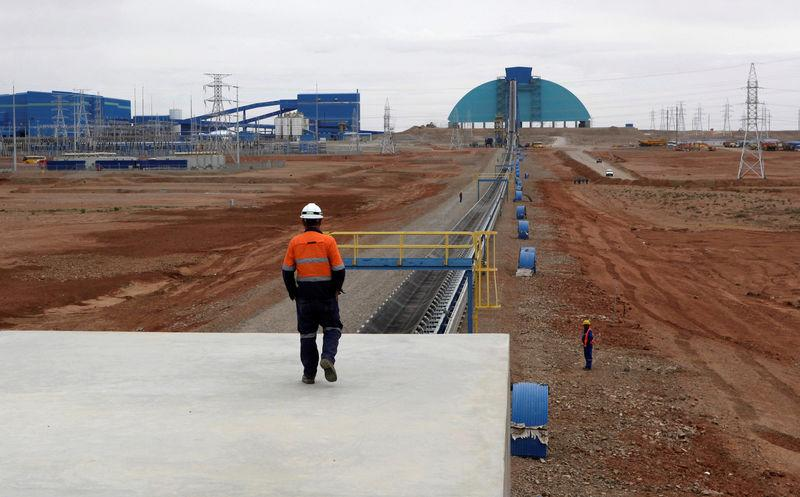 FILE PHOTO - An employee looks at the Oyu Tolgoi mine in Mongolia's South Gobi region
