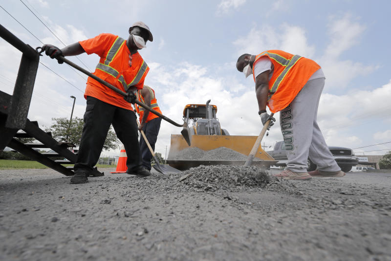 Construction workers from the Louisiana Department of Transportation and Development work in the heat on a road grading project on Airline Highway in St. Rose, La., Tuesday, Aug. 13, 2019. Forecasters say most of the South, from Texas to parts of South Carolina, will be under heat advisories and warnings as temperatures will feel as high as 117 degrees. (AP Photo/Gerald Herbert)