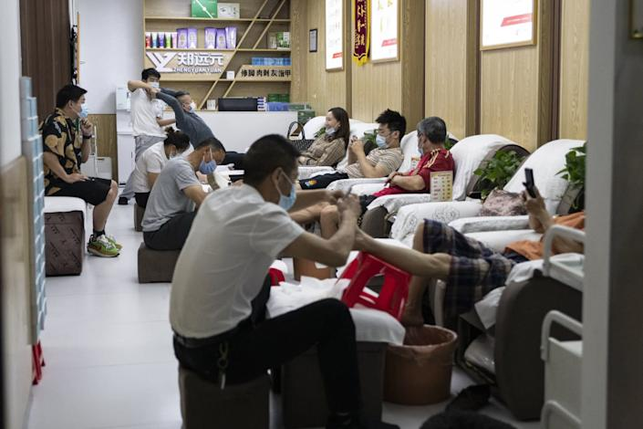 """People in Wuhan, China, wear protective masks in a massage parlor. Such businesses had finally begun to reopen. <span class=""""copyright"""">(For The Times)</span>"""