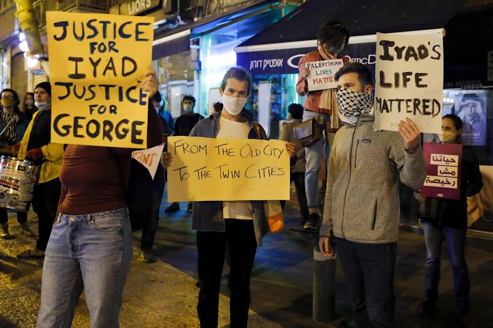 Israeli demonstrators carry placards during a demonstration condemning the shooting of Iyad Hallak, a disabled Palestinian man who was shot dead by Israeli police: Photo by AHMAD GHARABLI/AFP via Getty Images