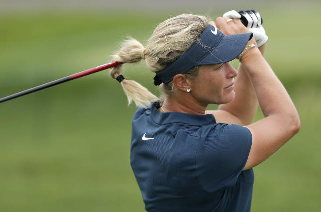 FILE - In this Thursday, July 13, 2017 file photo, Suzann Pettersen, of Norway, watches her tee shot on the ninth hole during the first round of the U.S. Women's Open Golf tournament, in Bedminster, N.J. Pettersen has been handed a Solheim Cup wild card despite having played just two events since November 2017. (AP Photo/Seth Wenig, File)