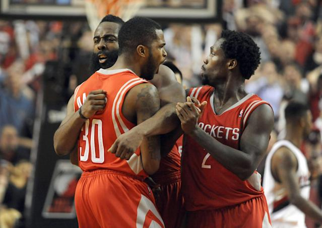 PORTLAND, OR - APRIL 25: Troy Daniels #30 of the Houston Rockets is mobbed by teammates James Harden #13 and Patrick Beverley #2 after hitting what ended up being the game winning shot during overtime of Game Three of the Western Conference Quarterfinals during the 2014 NBA Playoffs against the Portland Trail Blazers at the Moda Center on April 25, 2014 in Portland, Oregon. The Rockets won the game 121-116. (Photo by Steve Dykes/Getty Images)