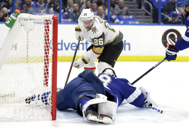 Tampa Bay Lightning goaltender Andrei Vasilevskiy (88) stretches out to stop a shot by Vegas Golden Knights center Paul Stastny (26) during the first period of an NHL hockey game Tuesday, Feb. 5, 2019, in Tampa, Fla. (AP Photo/Chris O'Meara)