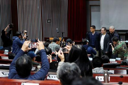 Media gather around Hong Kong's Occupy Central pro-democracy movement founders Chan Kin-man, Benny Tai and Chu Yiu-ming as they attend a forum in Taipei, Taiwan January 29, 2019. Picture taken January 29, 2019. REUTERS/Tyrone Siu