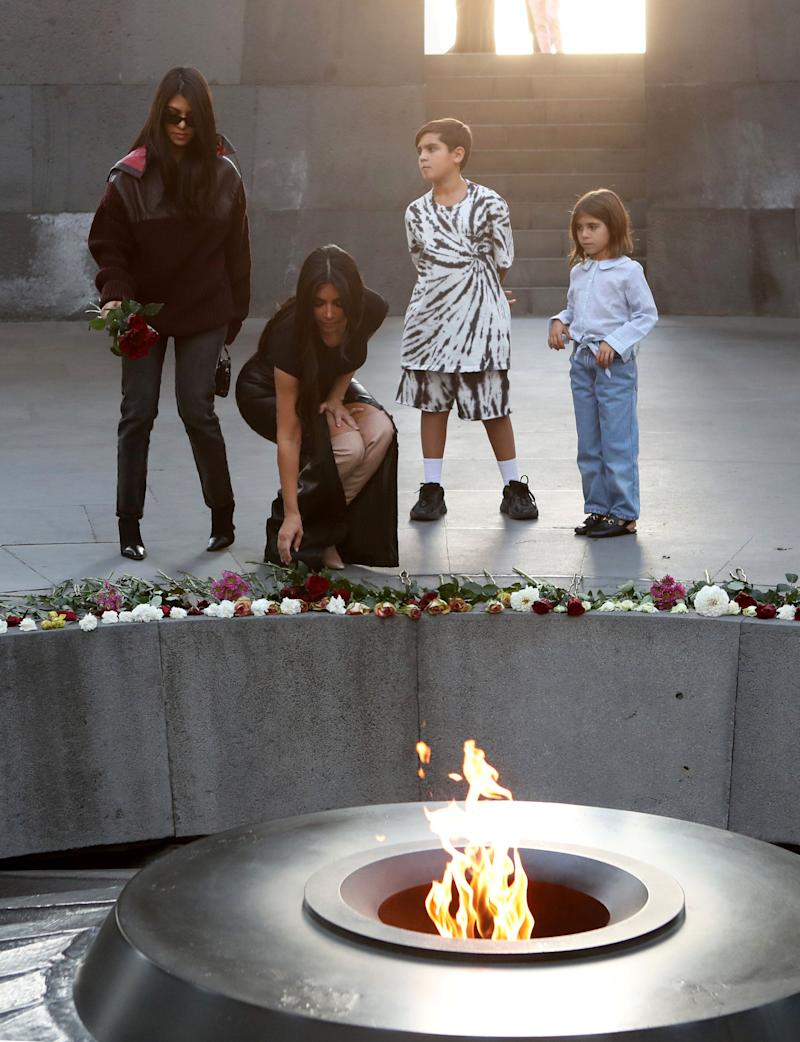 Reality TV personality Kim Kardashian and her sister Kourtney Kardashian with children visit the Armenian Genocide Memorial in Yerevan, Armenia on Tuesday. (Photo: Reuters)