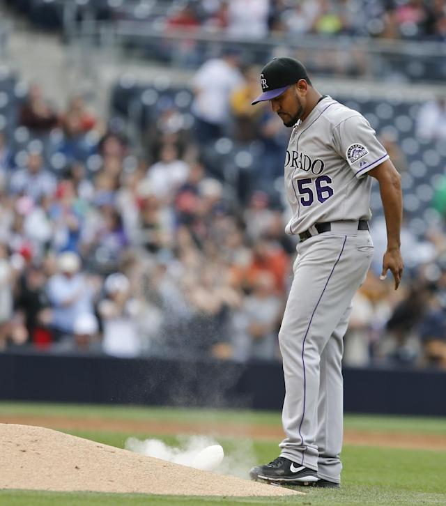 Colorado Rockies starting pitcher Franklin Morales sends up a cloud of rosin while slamming the bag after surrendering a home run to San Diego Padres' Xavier Nady during the fourth inning of a baseball game Thursday, April 17, 2014, in San Diego. (AP Photo/Lenny Ignelzi)
