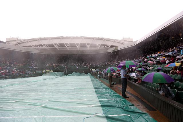 LONDON, ENGLAND - JULY 08: A general view of atmosphere as rain delays play on day thirteen of the Wimbledon Lawn Tennis Championships at the All England Lawn Tennis and Croquet Club on July 8, 2012 in London, England. (Photo by Julian Finney/Getty Images)