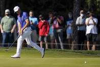 Justin Thomas reacts after missing a putt on the 15th hole during the final round of The Players Championship golf tournament Sunday, March 14, 2021, in Ponte Vedra Beach, Fla. (AP Photo/Gerald Herbert)