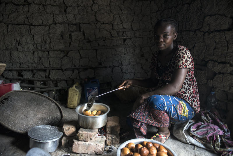 A mother whose sons contracted sleeping sickness in the village of Isangi makes doughnuts in her kitchen. (Neil Brandvold/DNDi)