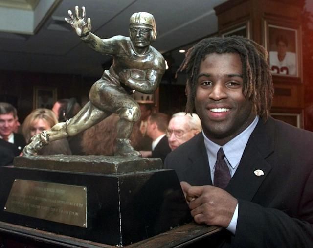 "<a class=""link rapid-noclick-resp"" href=""/ncaaf/players/306410/"" data-ylk=""slk:Ricky Williams"">Ricky Williams</a>' 1998 Heisman Trophy was sold on Friday for a record amount. (Photo credit should read ADAM NADEL/AFP/Getty Images)"