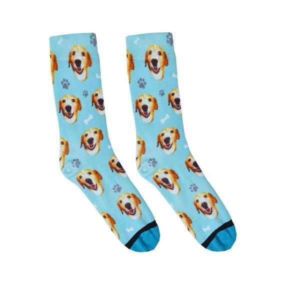 """<p><strong>DivvyUpSocks</strong></p><p>etsy.com</p><p><strong>$24.00</strong></p><p><a href=""""https://go.redirectingat.com?id=74968X1596630&url=https%3A%2F%2Fwww.etsy.com%2Flisting%2F529611523%2Fcustom-dog-socks-put-your-dog-on-a-sock&sref=https%3A%2F%2Fwww.goodhousekeeping.com%2Fholidays%2Fgift-ideas%2Fg29302190%2Funique-etsy-gifts%2F"""" rel=""""nofollow noopener"""" target=""""_blank"""" data-ylk=""""slk:Shop Now"""" class=""""link rapid-noclick-resp"""">Shop Now</a></p><p><a href=""""https://www.goodhousekeeping.com/life/pets/g27207250/dog-mom-gifts/"""" rel=""""nofollow noopener"""" target=""""_blank"""" data-ylk=""""slk:Dog moms"""" class=""""link rapid-noclick-resp"""">Dog moms</a> might just go crazy over these <a href=""""https://www.goodhousekeeping.com/holidays/gift-ideas/g4593/funny-gag-gift-ideas/"""" rel=""""nofollow noopener"""" target=""""_blank"""" data-ylk=""""slk:gag gift"""" class=""""link rapid-noclick-resp"""">gag gift</a> socks, which are actually kind of adorable. Submit the best photo of her furry friend and the seller will take care of the rest. </p>"""