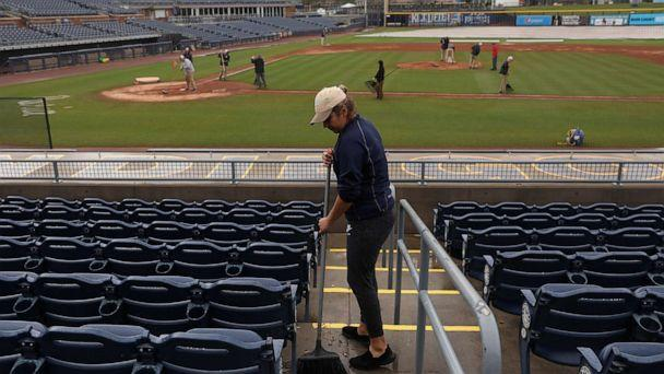 PHOTO: Cleaning crews work inside of Peoria Stadium on March 12, 2020, in Peoria, Ariz. (Christian Petersen/Getty Images)