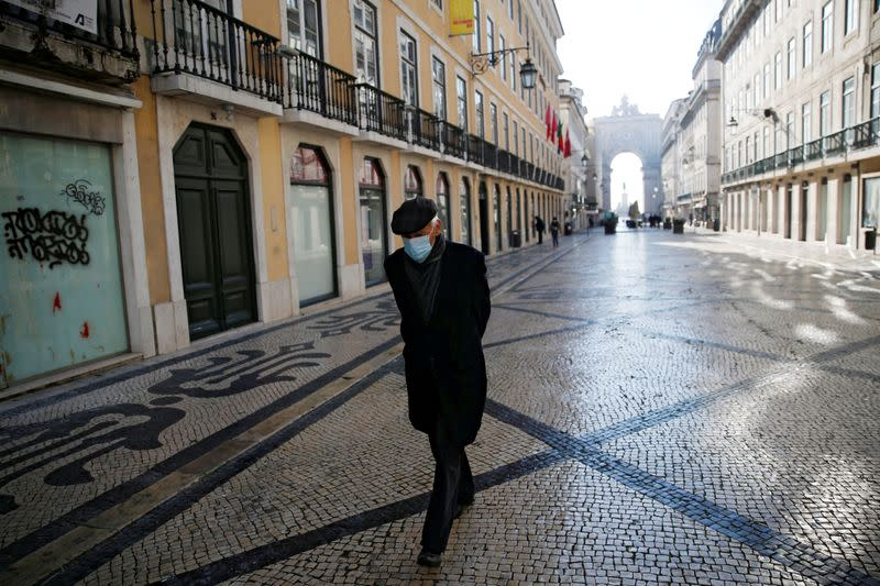 FILE PHOTO: A man waks in downtown Lisbon on the first day of the second national lockdown due to the coronavirus disease (COVID-19) pandemic in Lisbon