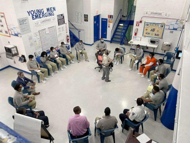 PHOTO: Inmates in the Young Men Emerging mentorship program at D.C. jail study economics and personal finance with Joel Caston, the program's founder and a convicted felon. (ABC News)