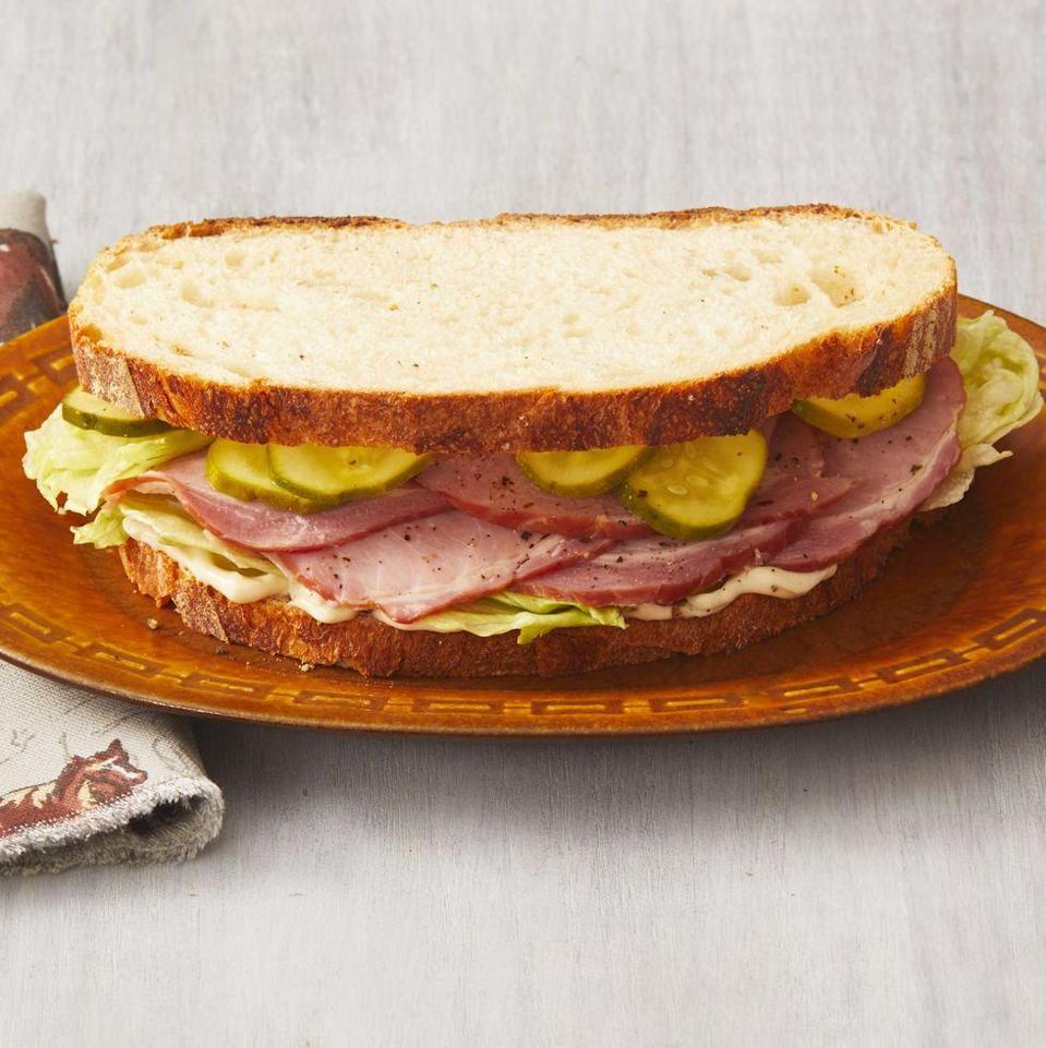 """<p>You don't have to order a party sub this year—make these ham sandwiches instead. You'll love the quick pickles!</p><p><strong><a href=""""https://www.thepioneerwoman.com/food-cooking/recipes/a34292699/ham-sandwiches-with-quick-pickles-recipe/"""" rel=""""nofollow noopener"""" target=""""_blank"""" data-ylk=""""slk:Get the recipe."""" class=""""link rapid-noclick-resp"""">Get the recipe.</a></strong></p><p><strong><a class=""""link rapid-noclick-resp"""" href=""""https://go.redirectingat.com?id=74968X1596630&url=https%3A%2F%2Fwww.walmart.com%2Fbrowse%2Fhome%2Fthe-pioneer-woman-plates%2F4044_623679_639999_2113437_9360029&sref=https%3A%2F%2Fwww.thepioneerwoman.com%2Ffood-cooking%2Fmeals-menus%2Fg35049189%2Fsuper-bowl-food-recipes%2F"""" rel=""""nofollow noopener"""" target=""""_blank"""" data-ylk=""""slk:SHOP PLATES"""">SHOP PLATES</a><br></strong></p>"""