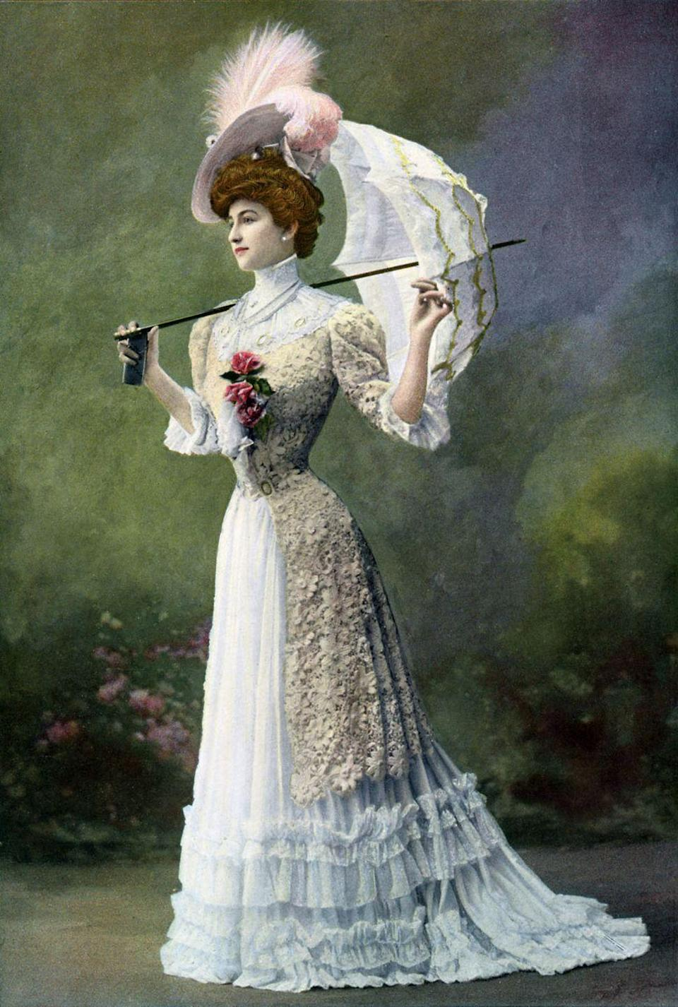 <p>At the tail end of the Victorian era, dresses became more playful with lace, ruffles, and feather details. But high necks were still key. </p>