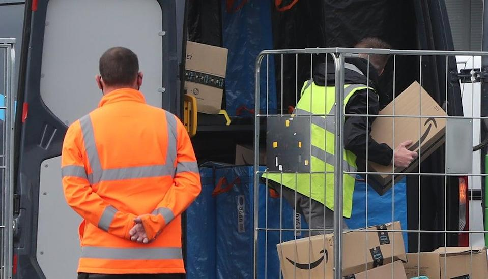 Electric delivery vans are packed at the Amazon warehouse in Belfast (Niall Carson/PA Wire) (PA Wire)