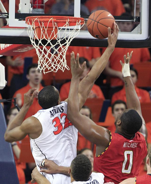 Virginia forward Darion Atkins (32) grabs a rebound in front of Maryland forward Charles Mitchell (0) during the second half of an NCAA college basketball game in Charlottesville, Va., Monday, Feb. 10, 2014. Virginia won the game 61-53. (AP Photo/Steve Helber)