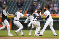 Detroit Tigers' Harold Castro (30) celebrates his game winning single against the Chicago Cubs in the 10th inning of a baseball game in Detroit, Saturday, May 15, 2021. Detroit won 9-8. (AP Photo/Paul Sancya)
