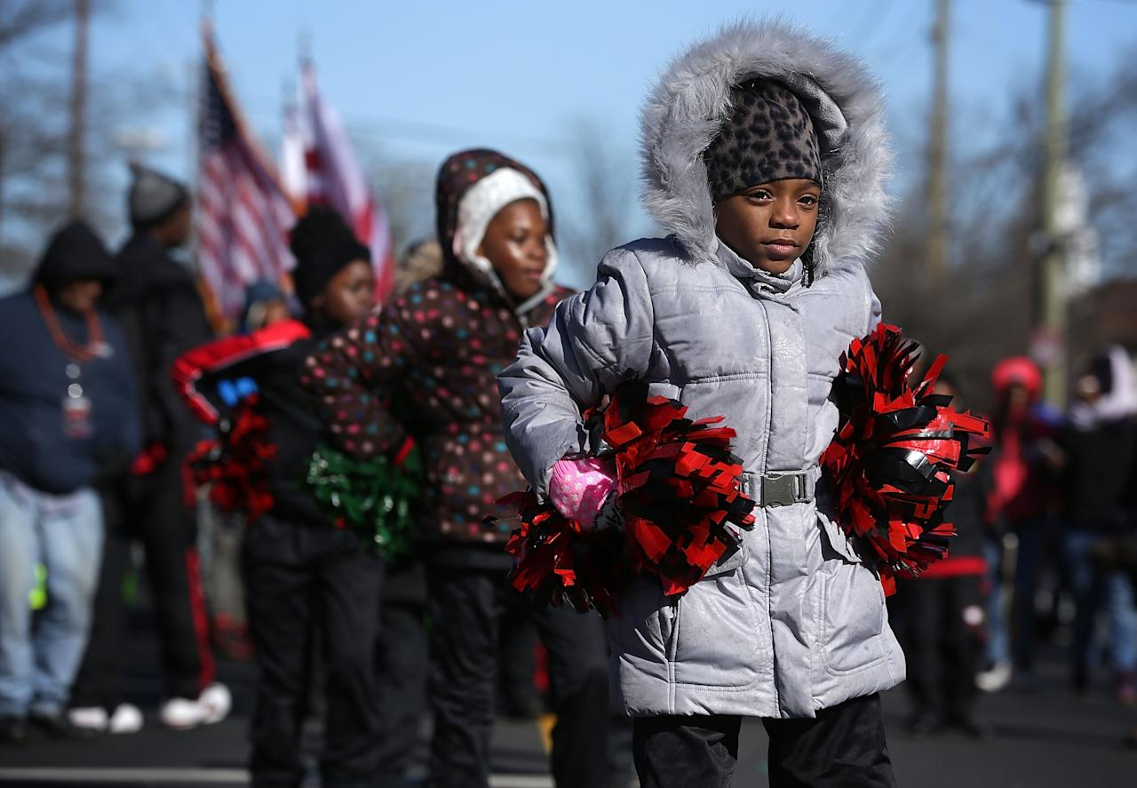 WASHINGTON, DC - JANUARY 18:  Children participate in the annual Martin Luther King Holiday Peace Walk and Parade January 18, 2016 in Washington, DC. The nation observes the life and legacy of Martin Luther King Jr. today. (Photo by Alex Wong/Getty Images)