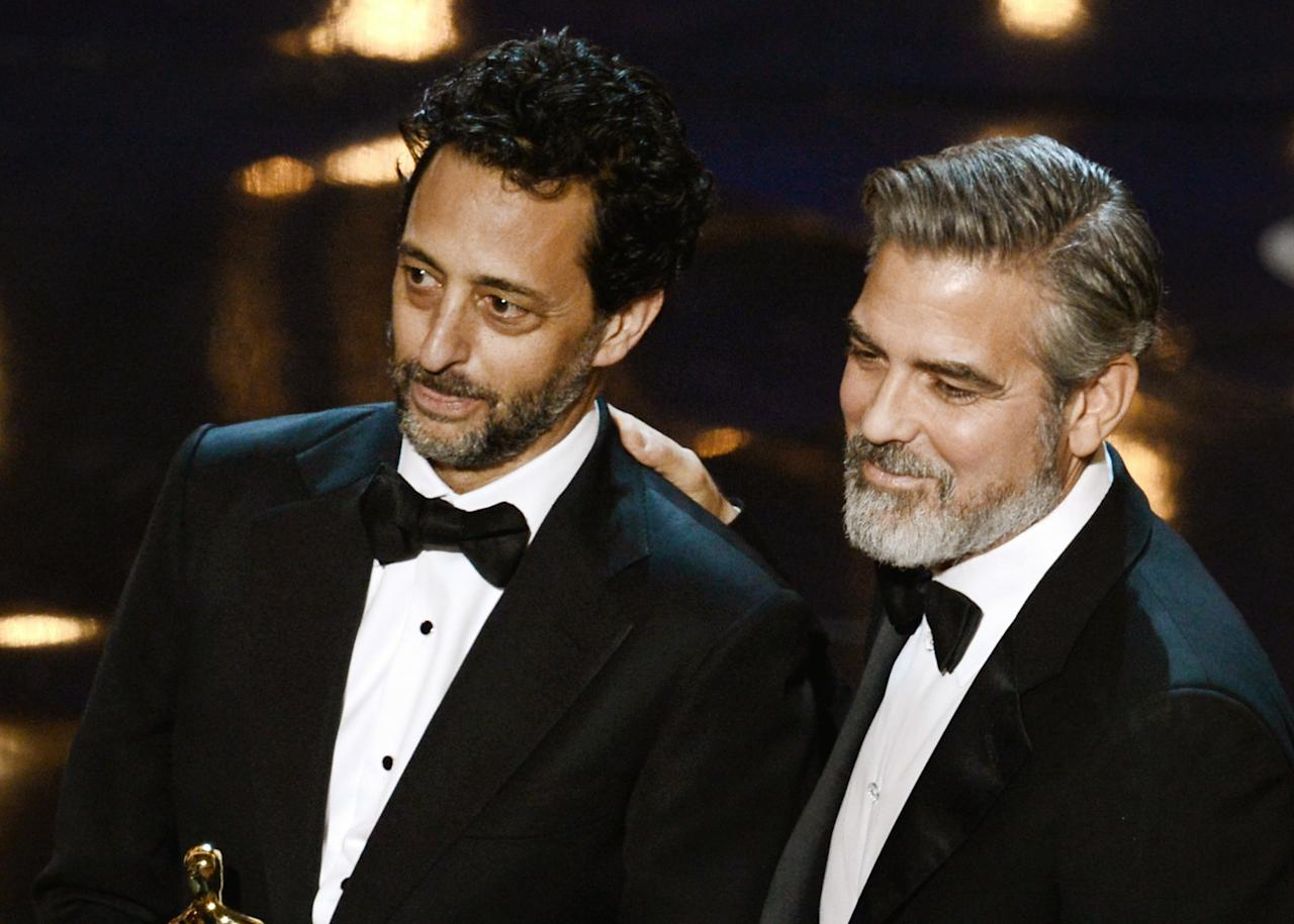 "HOLLYWOOD, CA - FEBRUARY 24:  Producer Grant Heslov and producer George Clooney accept the Best Picture award for ""Argo"" along with members of the cast and crew onstage during the Oscars held at the Dolby Theatre on February 24, 2013 in Hollywood, California.  (Photo by Kevin Winter/Getty Images)"