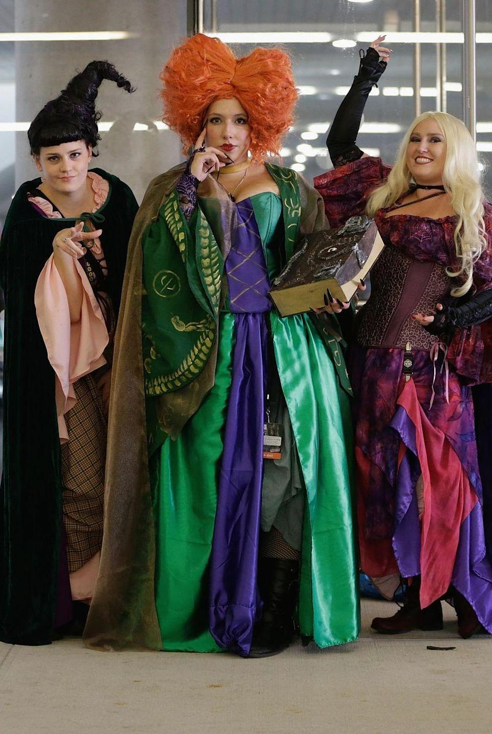 """<p>You'll put a spell on everyone if you and your girls dress up as the Sanderson Sisters from <em>Hocus Pocus</em>.</p><p><a class=""""link rapid-noclick-resp"""" href=""""https://www.amazon.com/Spirit-Halloween-Winifred-Wig-Deluxe/dp/B0728DQ8YD?tag=syn-yahoo-20&ascsubtag=%5Bartid%7C10070.g.2683%5Bsrc%7Cyahoo-us"""" rel=""""nofollow noopener"""" target=""""_blank"""" data-ylk=""""slk:SHOP WINIFRED WIG"""">SHOP WINIFRED WIG</a></p>"""