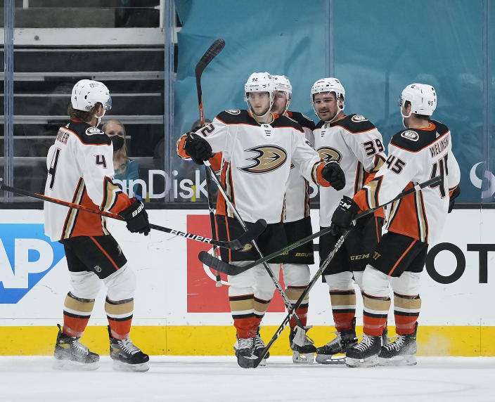 Anaheim Ducks right wing Alexander Volkov (92) celebrates with teammates Cam Fowler (4), Sam Carrick (39), and Andy Welinski (45) after scoring a goal against the San Jose Sharks during the first period of an NHL hockey game Monday, April 12, 2021, in San Jose, Calif. (AP Photo/Tony Avelar)