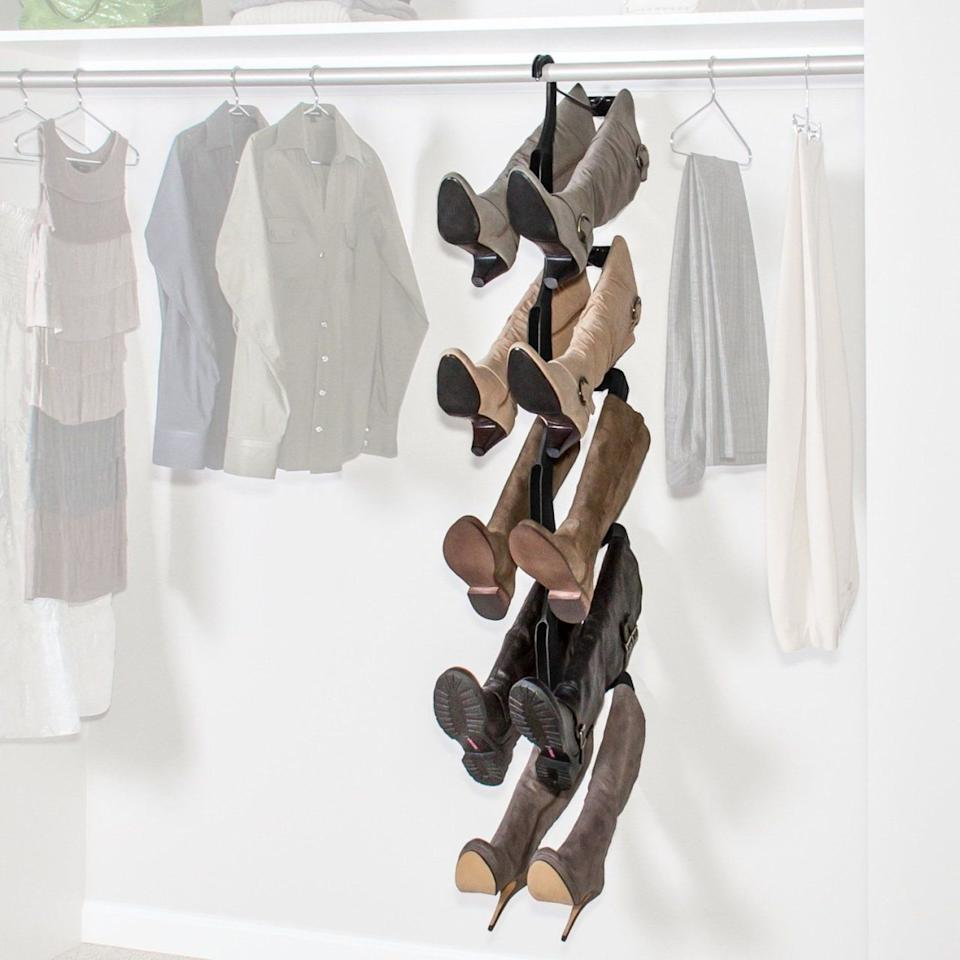 "<p>Don't <a rel=""nofollow"" href=""http://www.housebeautiful.com/lifestyle/organizing-tips/tips/g911/closet-organization-ideas/?slide=1"">waste floor or shelf space</a> on boots. This hanging rack <em>($70, <a rel=""nofollow"" href=""https://www.amazon.com/dp/B00IFQWK04?tag=syndication-20&psc=1"">amazon.com</a></em><em>)</em> only takes up the storage space of a few dresses and will extend the life of your boots by preserving their shape, too.</p>"