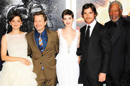 "From left, actors Marion Cotillard, Gary Oldman, Anne Hathaway, Christian Bale, and Morgan Freeman pose together at the world premiere of ""The Dark Knight Rises"" on Monday July 16, 2012, in New York. (Photo by Evan Agostini/Invision/AP)"