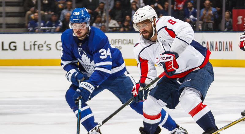 TORONTO, ON - FEBRUARY 21: Alex Ovechkin #8 of the Washington Capitals battles with Auston Matthews #34 and Jake Gardiner #51 of the Toronto Maple Leafs during the second period at the Scotiabank Arena on February 21, 2019 in Toronto, Ontario, Canada. (Photo by Mark Blinch/NHLI via Getty Images)